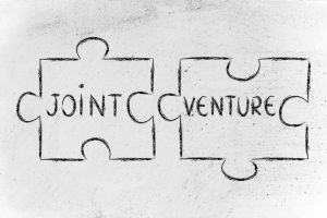 Two pieces of puzzle describing a joint-venture in China